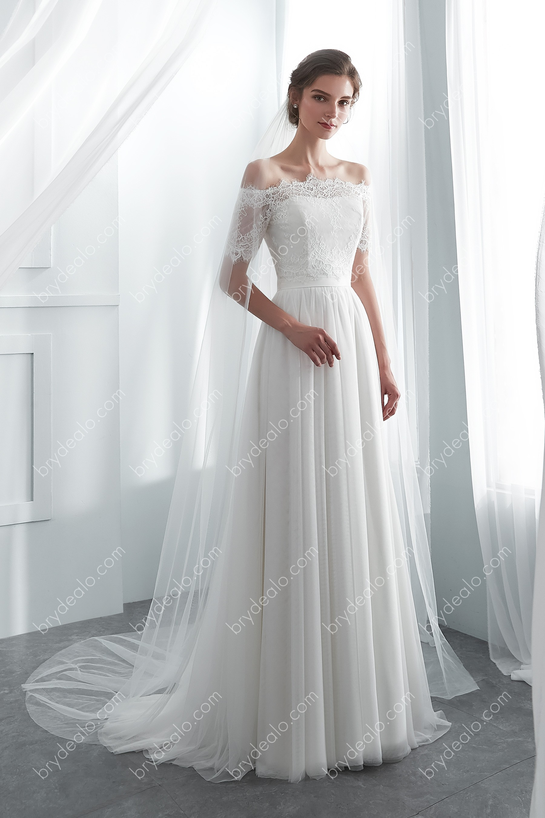 Ivory Lace Net A Line Modern Bridal Gown With Detachable Bolero